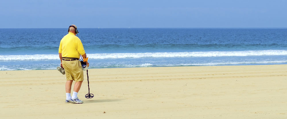 A detectorist at the beach